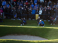 26.09.2014. Gleneagles, Auchterarder, Perthshire, Scotland.  The Ryder Cup.  Rory McIlroy (EUR) lines up a putt on the first hole during the Friday Fourballs.