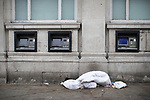 © Joel Goodman - 07973 332324 . 06/04/2017 . Manchester , UK . A duvet left on the pavement by cash machines adjacent to bus stops in Piccadilly Gardens . An epidemic of abuse of the drug spice by some of Manchester's homeless population , in plain sight , is causing users to experience psychosis and a zombie-like state and is daily being witnessed in the Piccadilly Gardens area of Manchester , drawing large resource from paramedic services in the city centre . Photo credit : Joel Goodman