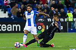 Diego Rico of Club Deportivo Leganes competes for the ball with  Carlos Henrique Casemiro of Real Madrid during the match of  La Liga between Club Deportivo Leganes and Real Madrid at Butarque Stadium  in Leganes, Spain. April 05, 2017. (ALTERPHOTOS / Rodrigo Jimenez)