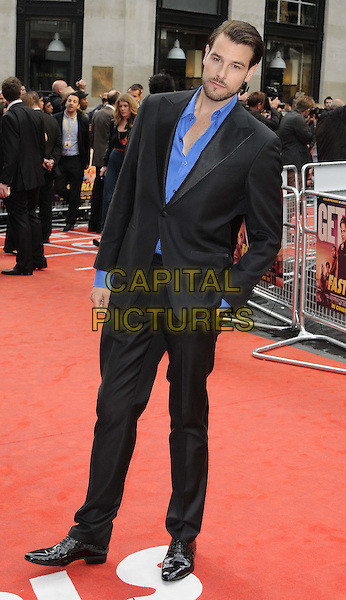 Regan Hall, director.The 'Fast Girls' UK film premiere, Odeon West End cinema, Leicester Square, London, England..June 7th, 2012.full length black suit blue shirt.CAP/CAN.©Can Nguyen/Capital Pictures.