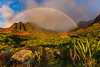 Double rainbow over Kalalau valley on the na pali coastline of Kauai.