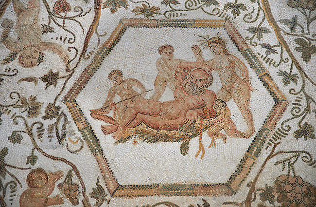 Picture of a Roman mosaics design depicting Silenus and Cupids, from the House of Sienus, ancient Roman city of Thysdrus. 3rd century AD. El Djem Archaeological Museum, El Djem, Tunisia.<br /> <br /> The Silenus Roman mosaic depicts multiple scenes : the tying up of Silenus, who is permanently drunk, and is depicted in the middle of the mosaic lying on a bed of leaves. Around him children are trying to tie his hands and legs with garlands of flowers.