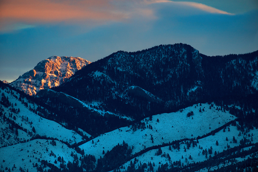 The first light of dawn illuminates Ross Peak in the Bridger Mountain north of Bozeman, Montana.