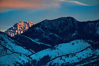 The first light of dawn illuminates Ross Peak in the Bridger Mountain north of Bozeman, Montana.