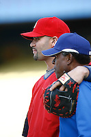 Albert Pujols of the St. Louis Cardinals spends time with Los Angeles Dodgers coach Manny Mota before a game from the 2007 season at Dodger Stadium in Los Angeles, California. (Larry Goren/Four Seam Images)