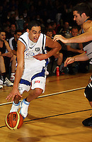 Saints guard Reece Cassidy tries to get past Cougars guard Luke Ruscoe during the NBL match between the Wellington Saints and Christchurch Cougars at Te Rauparaha Stadium, Porirua, Wellington, New Zealand on Saturday 4 April 2009. Photo: Dave Lintott / lintottphoto.co.nz