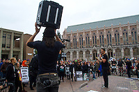 Activist Jake Conroy from the Animal Defense League in San Francisco, Calif. addresses a crowd during a protest against the new animal underground animal research facility being built on the University of Washington campus on October 2, 2015. (photo Karen Ducey photography).