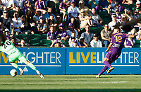 11th January 2020; HBF Park, Perth, Western Australia, Australia; A League Football, Perth Glory versus Adelaide United; Christopher Ikonomidis of the Perth Glory slips the ball past the attempted block from Paul Izzo of Adelaide United to score in the 69th minute and make the score 3-0 to Perth Glory - Editorial Use