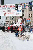 A team leave the ceremonial start line with an Iditarider at 4th Avenue and D Street in downtown Anchorage, Alaska on Saturday, March 5th during the 2016 Iditarod race. Photo by Joshua Borough/SchultzPhoto.com