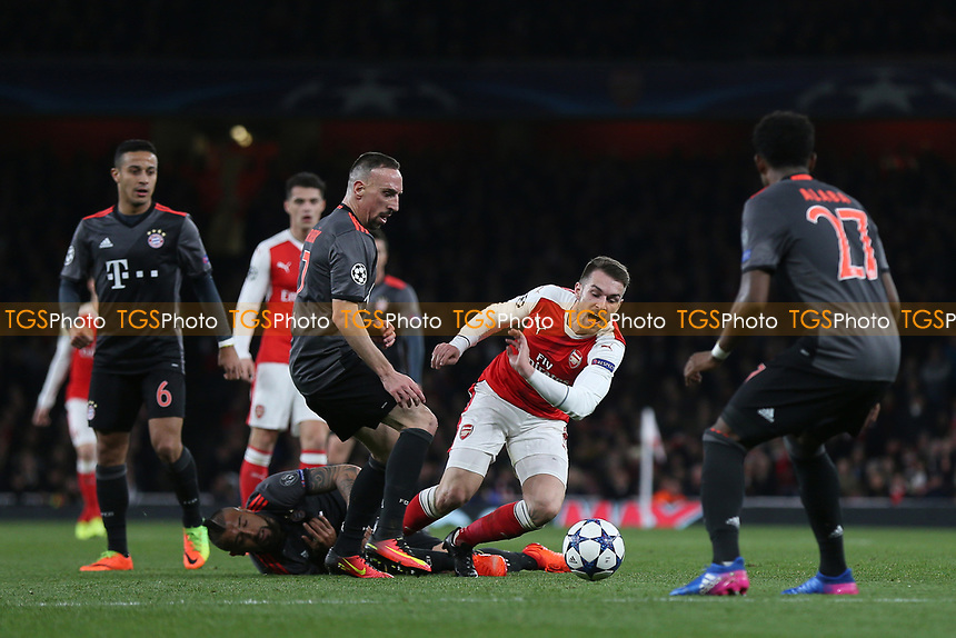 Aaron Ramsey of Arsenal tries to evade a challenge from FC Bayern Munich's Arturo Vidal during Arsenal vs FC Bayern Munich, UEFA Champions League Football at the Emirates Stadium on 7th March 2017