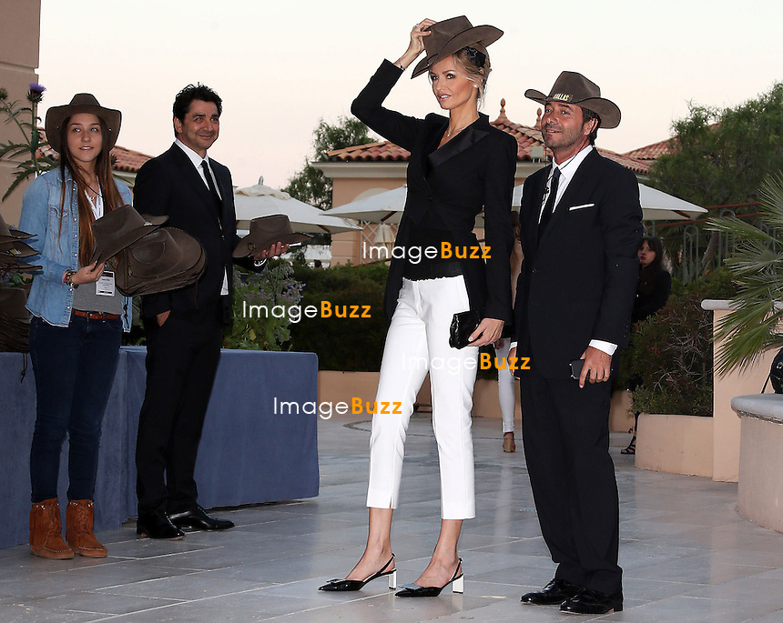 "ADRIANA KAREMBEU & BERNARD MONTIEL - June 12, 2013-53rd Monte-Carlo TV Festival. Adriana Karembeu & Bernard Montiel attend the '"" Dallas' "" Party at the Monte-Carlo Bay hotel."