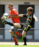 Wellington's Jamie Duncan clears the ball under pressure from Daniel Peat..NZFC soccer  - Team Wellington v Waikato FC at Newtown Park, Wellington. Sunday, 20 December 2009. Photo: Dave Lintott/lintottphoto.co.nz