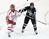 Justin Courtnall (BU - 19), Alex Velischek (PC - 27) - The Boston University Terriers defeated the visiting Providence College Friars 6-1 on Friday, January 20, 2012, at Agganis Arena in Boston, Massachusetts.