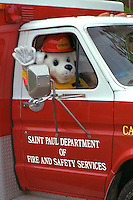Sparky the Safety Mascot waving in Grand Old Day Parade.  St Paul  Minnesota USA