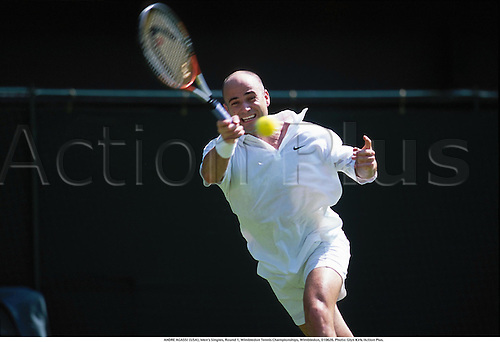 ANDRE AGASSI (USA), Men's Singles, Round 1, Wimbledon Tennis Championships, Wimbledon, 010626. Photo: Glyn Kirk/Action Plus....2001.tennis.man