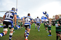 The Bath team run out onto the field. LV= Cup match, between Bath Rugby and London Welsh on November 1, 2014 at the Recreation Ground in Bath, England. Photo by: Patrick Khachfe / Onside Images