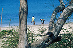 Morning Walk by Locals on Treasure Beach, Jamaica
