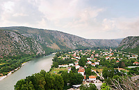View from the hilltop tower over the Neretva river and houses on the plain in the river valley. Pocitelj historic Muslim and Christian village near Mostar. Federation Bosne i Hercegovine. Bosnia Herzegovina, Europe.