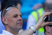 Cardiff fan and BBC broadcaster Jason Mohammad takes phone footage during the Sky Bet Championship match between Cardiff City and Reading at the Cardiff City Stadium, Cardiff, Wales on 6 May 2018. Photo by Mark  Hawkins / PRiME Media Images.