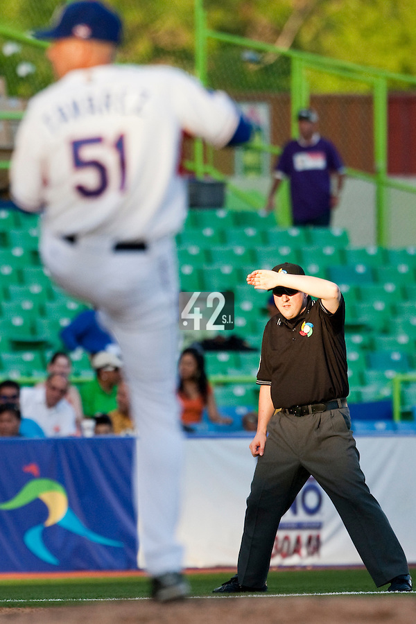 8 March 2009: Third base umpire Corrie Davis protects his eyes from the sun during the 2009 World Baseball Classic Pool D match at Hiram Bithorn Stadium in San Juan, Puerto Rico. Dominican Republic wins 9-0 over Panama.
