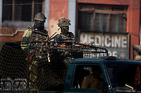 Indian army soldiers on a truck pass through the center of Srinagar as paramilitary police enforce a curfew imposed to stop separatists gather for a political demonstration in Srinagar, Kashmir, India. © Fredrik Naumann/Felix Features
