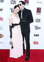 HOLLYWOOD, LOS ANGELES, CA, USA - SEPTEMBER 06: Lindsay Usich and Marilyn Manson arrive at the Los Angeles Premiere Of FX's 'Sons Of Anarchy' Season 7 held at the TCL Chinese Theatre on September 6, 2014 in Hollywood, Los Angeles, California, United States. (Photo by Xavier Collin/Celebrity Monitor)
