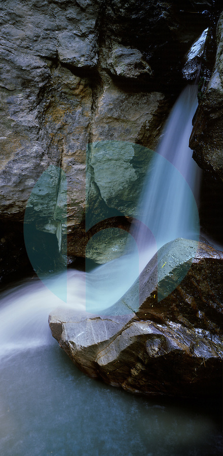 November 5th, 2003-Ermera, Timor-Leste- Majestic waters cascade onto a stone that has become polished over time in a remote stream near Eraulo Village in Ermera District.  Photograph by Daniel J. Groshong/Tayo Photo Group