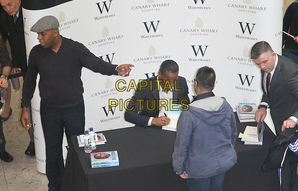 LONDON, ENGLAND - NOVEMBER 25: Didier Drogba signs copies of his book 'Commitment' at Waterstones Canary Wharf on November 25, 2015 in London, England.<br /> CAP/DS<br /> &copy;DS/Capital Pictures