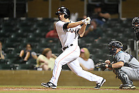 Salt River Rafters infielder Austin Nola (9) at bat in front of catcher Justin O'Conner during an Arizona Fall League game against the Peoria Javelinas on October 17, 2014 at Salt River Fields at Talking Stick in Scottsdale, Arizona.  The game ended in a 3-3 tie.  (Mike Janes/Four Seam Images)