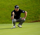 16.10.2014. The London Golf Club, Ash, England. The Volvo World Match Play Golf Championship.  Day 2 group stage matches.  Graeme McDowell [NIR] surveys a putt on the seventh hole.