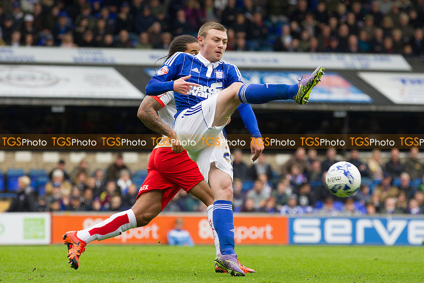 Freddie Sears, Ipswich Town clears under pressure from Sean Scannell, Huddersfield Town during Ipswich Town vs Huddersfield Town, Sky Bet Championship Football at Portman Road, Ipswich, England on 17/10/2015