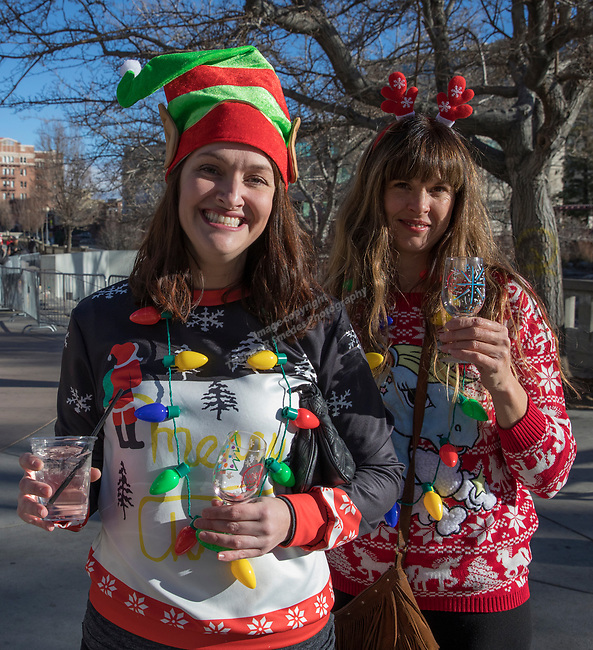 Megan and Lori during the Ugly Sweater Wine Walk in downtown  Reno on Saturday, Dec. 16, 2017.