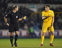 Preston's Referee Jeremy Simpson shows a yellow card to Preston's Jordan Hugill <br /> <br /> Photographer Jon Hobley/CameraSport<br /> <br /> The EFL Sky Bet Championship - Millwall v Preston North End - Saturday 13th January 2018 - The Den - London<br /> <br /> World Copyright &copy; 2018 CameraSport. All rights reserved. 43 Linden Ave. Countesthorpe. Leicester. England. LE8 5PG - Tel: +44 (0) 116 277 4147 - admin@camerasport.com - www.camerasport.com