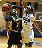 Jayla Jones-Pack #31 of St. Anthony's, left, looks to drive past Nukiya Mayo #11 of Monsignor Scanlan during the CHSAA varsity girls basketball Class AA state final at St. John Villa Academy in Staten Island, NY on Saturday, Mar. 12, 2016. St. Anthony's won by a score of 57-43.