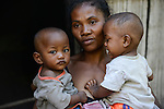 MADAGASCAR, Mananjary, tribe ANTAMBAHOAKA, fady, according to the rules of their ancestors twin children are a taboo and not accepted in the society, this mother is accepting her twin children but she has left her village and is living in the town / MADAGASKAR, Zwillinge sind ein Fady oder Tabu beim Stamm der ANTAMBAHOAKA in der Region Mananjary, Frau CLAUDINE MAROVAVY mit ihren Zwillingen JEAN PASCAL NOMENJANAHARY -rechts- und<br /> MARIE PASCALINE NOMENJANAHARY -links-, sie hat mit ihrem Mann die Zwillinge gegen das Tabu behalten und ihr Dorf verlassen und lebt heute in Mananjary im Stadtviertel ANALAJAVIDY