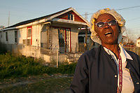 New Orleans, LA-- Gloria Gillard outside her heavily damaged home in the 9th Ward. Despite being invited to live in Canadaville, Gloria is slowly rebuilding and vows to stay, one of the few residents intent on returning to the area. Liam Maloney / Special to The Gazette