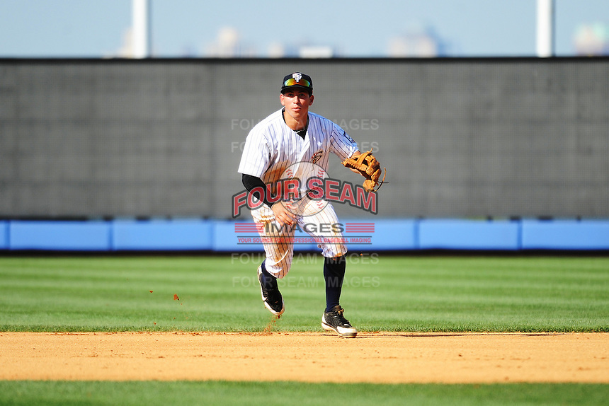 Staten Island Yankees infielder Hector Crespo (26) during game against the Connecticut Tigers at Richmond County Bank Ballpark at St.George on July 7, 2013 in Staten Island, NY.  Staten Island defeated Connecticut 6-2.  (Tomasso DeRosa/Four Seam Images)