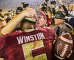 Florida State head coach Jimbo Fisher, right, talks with quarterback Jameis Winston after FSU defeated Notre Dame 31-27 in an NCAA college football game in Tallahassee, Fla., Saturday, Oct. 18, 2014.  AP Photo/Mark Wallheiser)