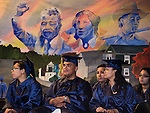 WATERBURY, CT- 8 June 2016-060816EC05-  Graduates Chelsea Ivana Booker, Angel Luis Rivera and Janelle Rosado sit on stage waiting for their diplomas Wednesday from The State Street School. Behind them is a mural of world leaders they painted. Erin Covey Republican-American
