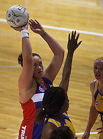 Catherine Latu shoots for the Mystics during the ANZ Netball Championship match between the Central Pulse and Northern Mystics, TSB Bank Arena, Wellington, New Zealand on Monday, 4 May 2009. Photo: Dave Lintott / lintottphoto.co.nz