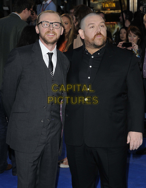 Simon Pegg & Nick Frost .'The Adventures of Tintin: The Secret of the Unicorn' UK film premiere, 55th BFI London Film Festival, Odeon West End cinema, Leicester Square, London, England..23rd October 2011.LFF half length black grey gray suit glasses beard facial hair  .CAP/CAN.©Can Nguyen/Capital Pictures.