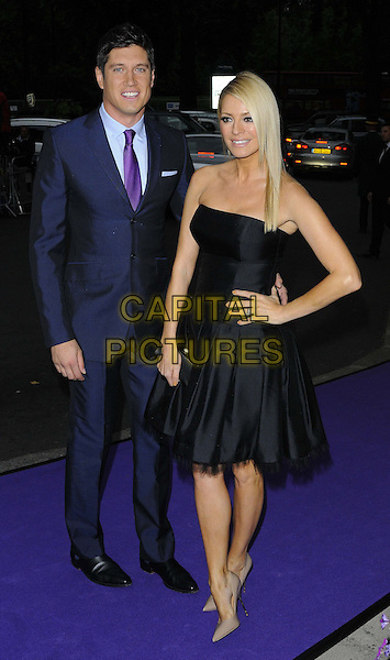 Vernon Kay &amp; Tess Daly<br /> The WellChild Awards 2013, The Dorchester, London, England.<br /> September 11th, 2013<br /> full length black dress strapless blue suit hand on hip married husband wife  <br /> CAP/CAN<br /> &copy;Can Nguyen/Capital Pictures
