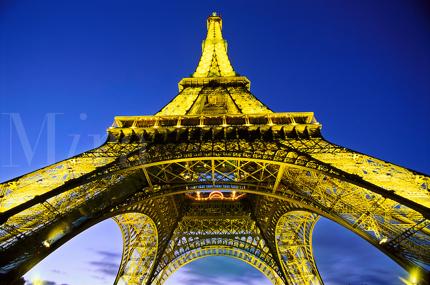 France, Paris. The Eiffel Tower illuminated at night viewed from below