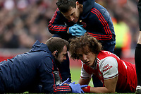 7th March 2020; Emirates Stadium, London, England; English Premier League Football, Arsenal versus West Ham United; David Luiz of Arsenal is checked for a head injury