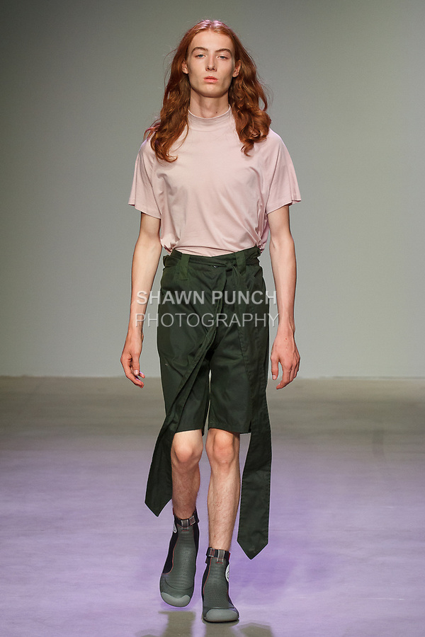 Model walks runway in an outfit from the N-p-Elliott Spring Summer 2018 collection at Skylight Clarkson Square on July 11, 2017; during New York Fashion Week: Men's Spring Summer 2018.