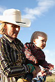 USA, Wyoming, Encampment, a woman and her son are dressed in cowboy attire, Abara Ranch