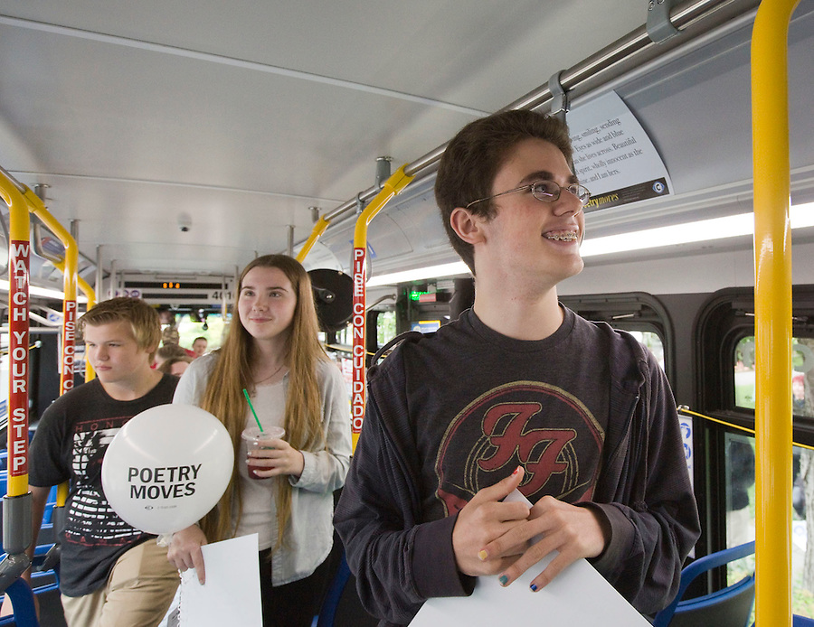 Jaden Lindsey (R) an 8th grader at the Vancouver School of Arts & Academics and Rheanna Nortz (C) a 9th grader at FT. Vancouver High School look at poems they wrote displayed in a bus in downtown Vancouver Sunday July 3, 2016. The C-Trans program, Poetry Moves features poems written by school kids, displayed in busses. (Photo by Natalie Behring/ The Columbian)