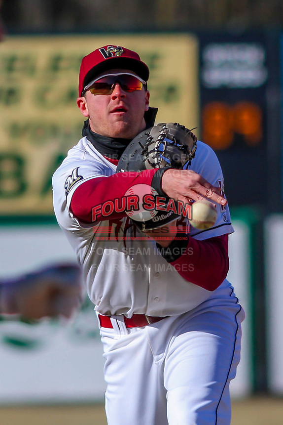 Wisconsin Timber Rattlers first baseman Pat McInerney (9) flips a ball to the pitcher covering first base during a Midwest League game against the Beloit Snappers on April 7, 2018 at Fox Cities Stadium in Appleton, Wisconsin. Beloit defeated Wisconsin 10-1. (Brad Krause/Four Seam Images)