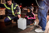 A fireman fills a child's water container at an emergency evacuation center for victims of the recent earthquake and tsunami. On 11 March 2011 a magnitude 9 earthquake struck 130 km off the coast of Northern Japan causing a massive Tsunami that swept across the coast of Northern Honshu. The earthquake and tsunami caused extensive damage and loss of life and damaged Fukushima nuclear reactor. Two of the power station's reactors sustained extensive damage after explosions at the plant.