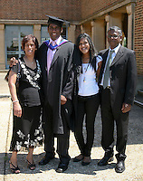 Happy graduate with his family, University of Surrey.